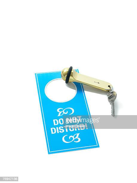 Hotel key and do not disturb sign