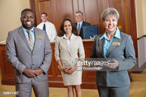 Hotel management and staff