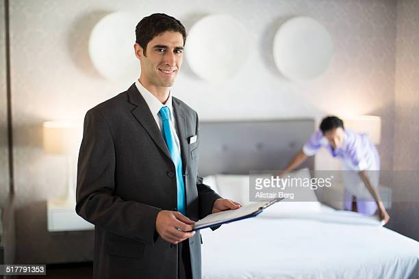 Hotel manager checking preparation of hotel room