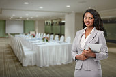 Lovely hotel manager standing in banquet hall