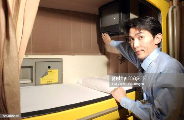Hotel manager Ryoji Matubara shows one of 175 capsule beds at the Refre Hotel Sapporo Japan The Refre Hotel will provide alternative accommodation...
