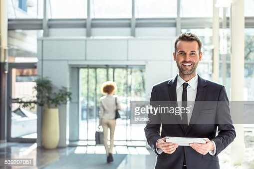 Hotel manager with a digital tablet