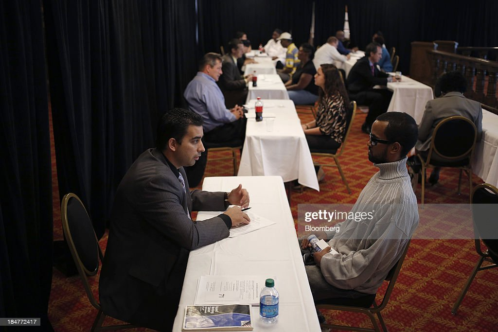 Hotel managers conduct interviews with job seekers who attended a job fair hosted by the Galt House Hotel in Louisville, Kentucky, U.S., on Monday, Oct. 14, 2013. Improvement in the U.S. labor market may soon speed up, building on gains during the past year, Federal Reserve researchers said, citing six employment indicators. Photographer: Luke Sharrett/Bloomberg via Getty Images