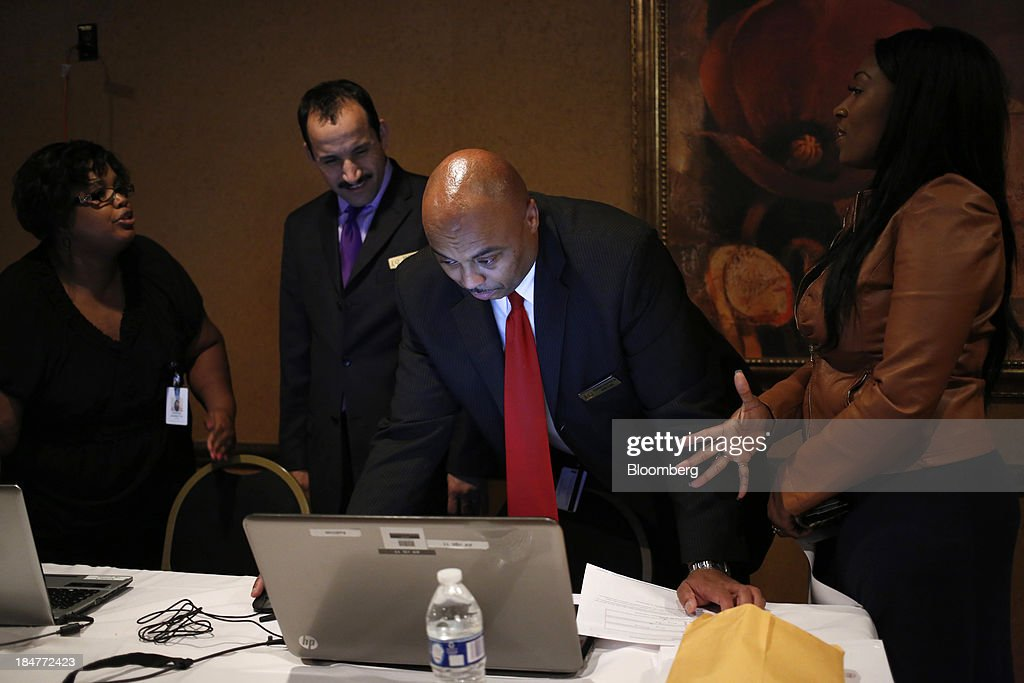 Hotel managers review an electronic test administered to job seekers who attended a job fair hosted by the Galt House Hotel in Louisville, Kentucky, U.S., on Monday, Oct. 14, 2013. Improvement in the U.S. labor market may soon speed up, building on gains during the past year, Federal Reserve researchers said, citing six employment indicators. Photographer: Luke Sharrett/Bloomberg via Getty Images