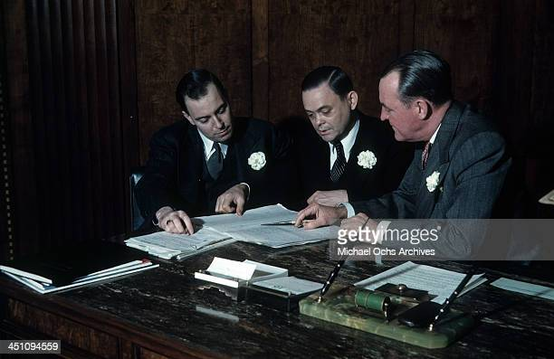 Hotel managers review the guest register for The Plaza Hotel in New York New York