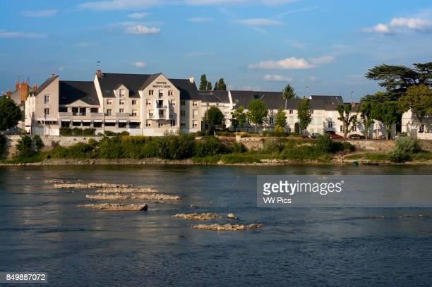 Hotel Mercure Loire river and Cessart bridge at Saumur commune in the MaineetLoire department Pays de la Loire region in western France