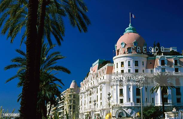 Hotel Negresco with palm tree in foreground.