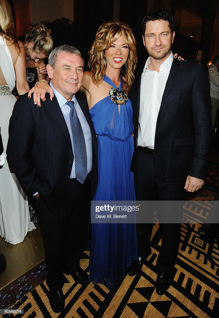 Hotel owner Sol Kerzner and wife Heather Kerzner with actor Gerard Butler attends the grand opening night of the Kerzner Mazagan Beach Resort on...