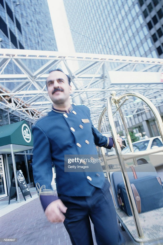 Hotel porter outside : Stock Photo