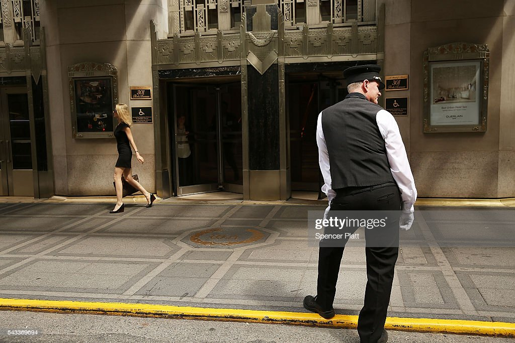 A hotel porter waits for guests at New York's landmark Waldorf Astoria Hotel on June 27, 2016 in New York City. China's Anbang Insurance Group, which recently purchased the Waldorf from Hilton Worldwide Holdings in 2014 for $1.95 billion, has announced plans to convert as much as three-quarters of the rooms into apartments. The insurer will close the Waldorf for up to three years starting next spring for the renovation.