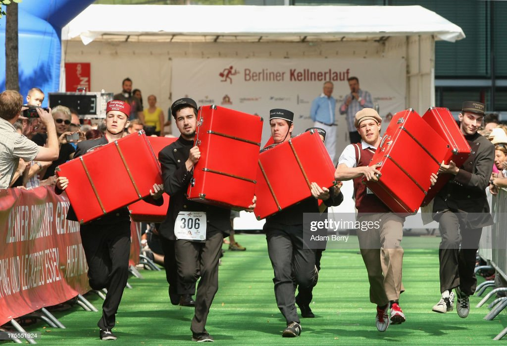Hotel porters run with suitcases during the Waiters' Derby (Kellner Derby in German) on August 4, 2013 in Berlin, Germany. At the annual event, brought back into existence in 2011 on the 125th anniversary of the Kurfuerstendamm (known locally as the Ku'damm), a main shopping thoroughfare, waiters, porters, cooks and bartenders run a 400-meter track while performing their regular occupational duties. The event was reinstated after a hiatus since the 1950s, when it was created to bring a sense of normal life back to Berlin after World War II under the Allies, a period in which gastronomical interest in the isolated Western part of the city suffered.