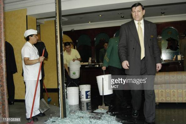 SANTIAGO CHILE Hotel Principado de Asturias employees clean up broken glass where part of the Russian delegation to the APEC summit conference were...