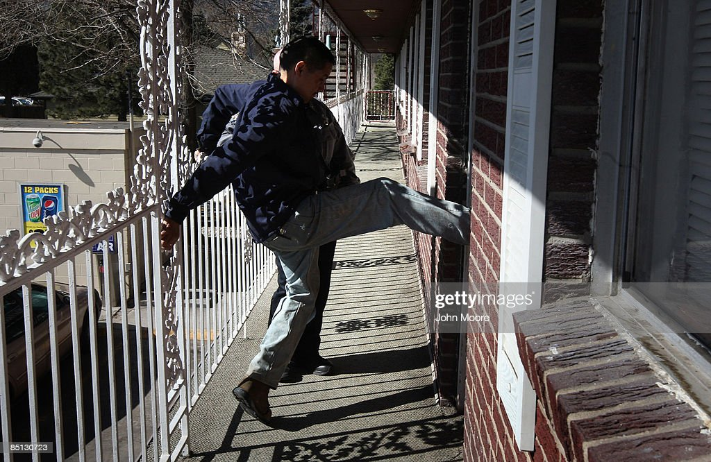 Hotel property manager Paul Martinez kicks in a tenant's door after no one answered the knock during an eviction February 26, 2009 in Colorado Springs, Colorado. The tenant, Rocki Holmes, said that he was laid off from his job in a retail store two months ago and had fallen behind on his rent payments at the low-budget hotel. Today a sheriff's deputy supervised as Martinez kicked in the door and then moved out all of Holmes' belongings onto the street below.
