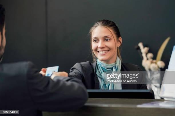 Hotel receptionist helping customer
