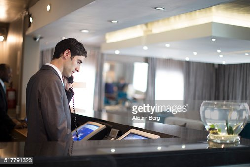 Hotel receptionist on phone