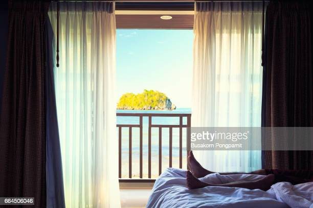 hotel room with bed and view in a beautiful blue sky and in the sea