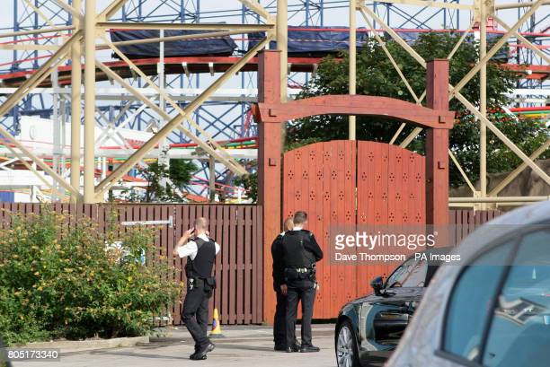 Hotel security staff stand beneath 3 carriages on the Big Dipper a ride at Blackpool Pleasure Beach where a number of people were injured last night...