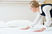 Hotel service. Made making bed linen in room