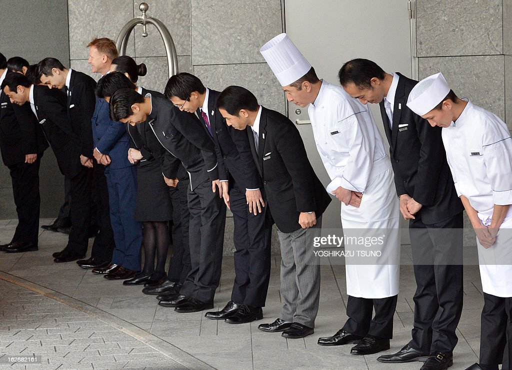 Hotel staff bow their heads to greet members of of the International Olympic Committee's (IOC) evaluation commission for the host city of the 2020 Olympic Games at a hotel in Tokyo on March 1, 2013. A 14-member team from the IOC will kick off a four-day mission on March 4 to check Tokyo's Olympic blueprint with bid leaders and inspect facilities planned for the Games. AFP PHOTO / Yoshikazu TSUNO