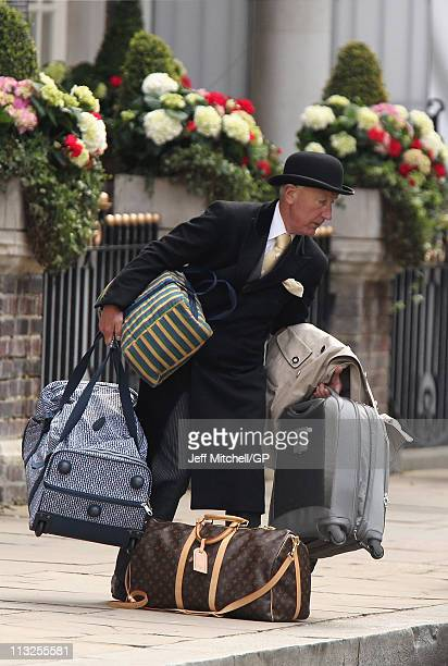 Hotel staff help guests as they arrive at the Goring Hotel where Kate Middleton will spend her last night before her marriage to Prince William on...