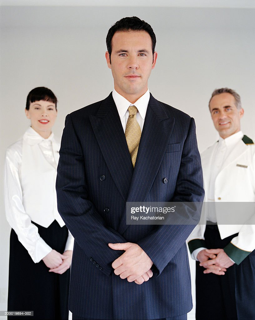 Hotel staff, manager in foreground : Stock Photo