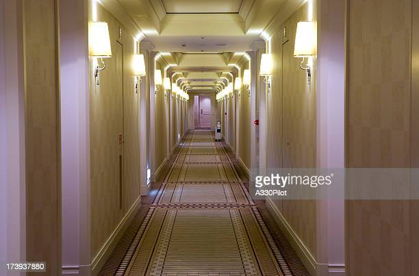 Hotel style, cream colored hallway with lamps