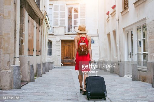 hotel, tourist walking with suitcase on the street : Stock Photo