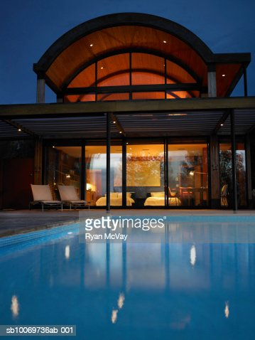 Hotel with swimming pool at night : Stock Photo