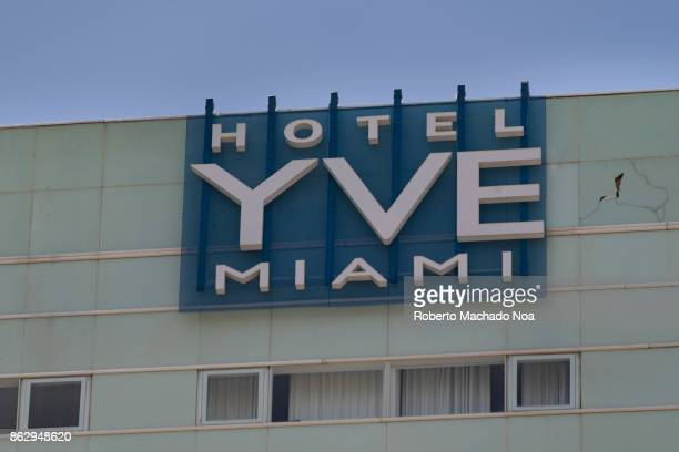 Hotel Yve signboard on building white metal lettering on translucent dark glass attached to the face of the building