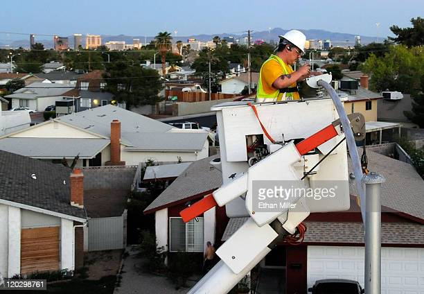 Hotelcasinos on the Las Vegas Strip are seen behind city of Las Vegas field electrician John Meier as he replaces a streetlight with a new LED...