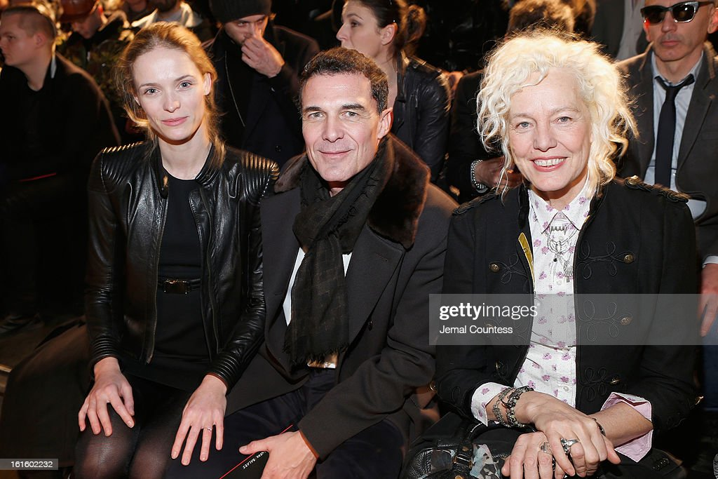 Hotelier Andre Balazs (C) and Photographer Ellen von Unwerth (R) attend the Diesel Black Gold Fall 2013 fashion show during Mercedes-Benz Fashion Week at Pier 57 on February 12, 2013 in New York City.