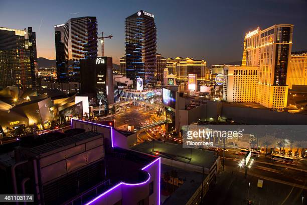 Hotels casinos and stores stand illuminated along The Strip at dusk in Las Vegas Nevada US on Tuesday Jan 6 2015 This year's Consumer Electronics...