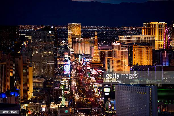 Hotels stand on The Strip in this aerial photograph taken at dusk above Las Vegas Nevada US on Wednesday Aug 5 2015 More than 21 million people have...