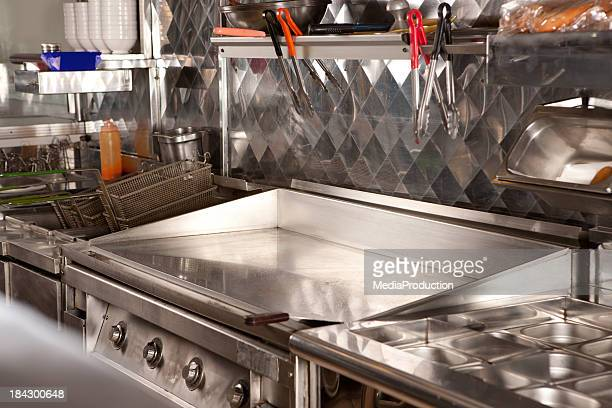 Hotplate cooker in  fast food restaurant kitchen