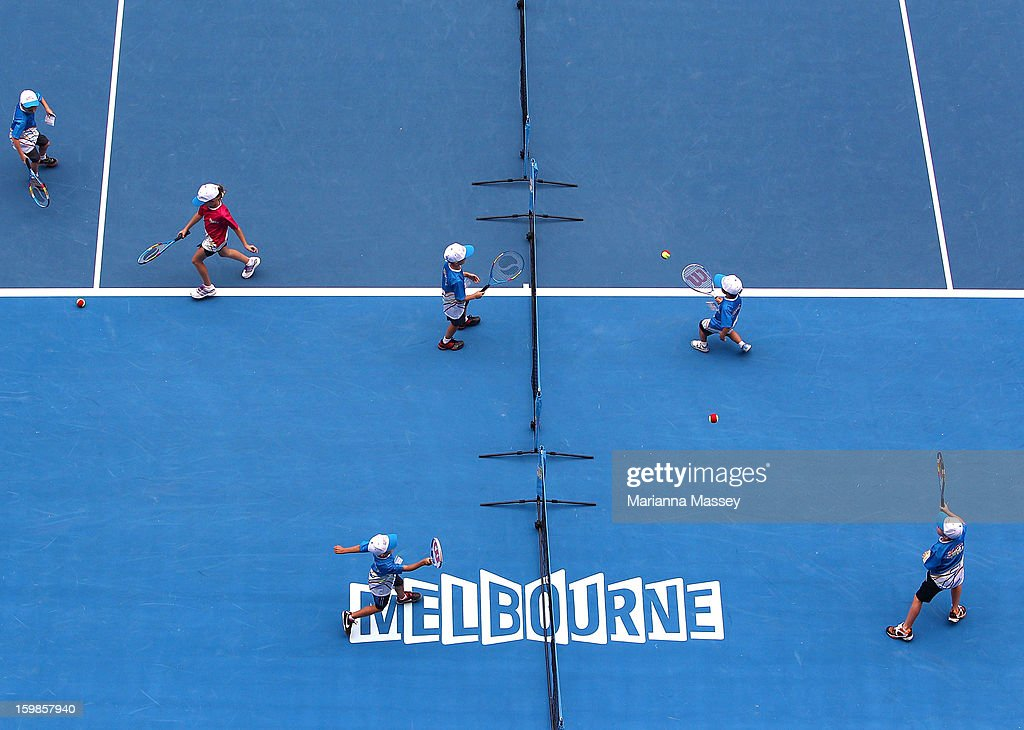 HotShots players play mini tennis on Rod Laver Arena during day nine of the 2013 Australian Open at Melbourne Park on January 22 2013 in Melbourne...