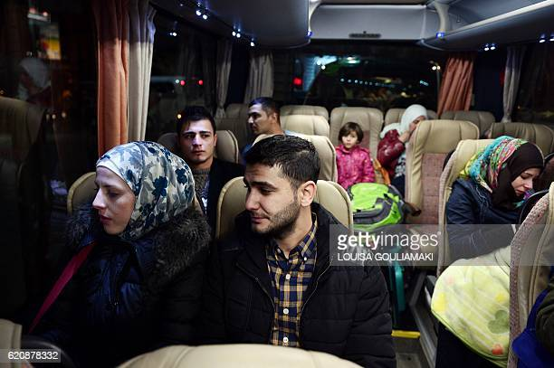 Houda Al Shaar and her husband Zaher Arhil sit in a bus on their way to take a special charter flight for France as part of the EU relocation program...