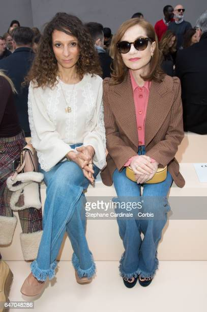Houda Benyamina and Isabelle Huppert attend the Chloe show as part of the Paris Fashion Week Womenswear Fall/Winter 2017/2018 on March 2 2017 in...
