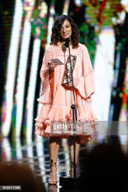 Houda Benyamina receives the Cesar of best first feature film for 'Divines' on stage during the Cesar Film Awards Ceremony at Salle Pleyel on...