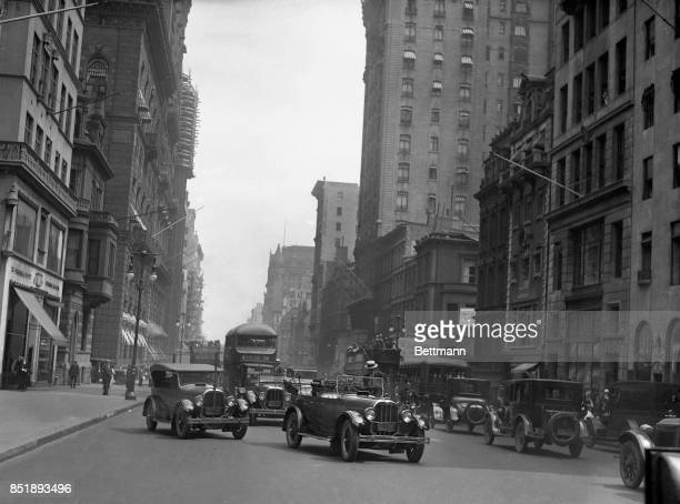 EP Houdina is seen here in New York City with his wireless automobile during a road test along Central Park on 59th Street