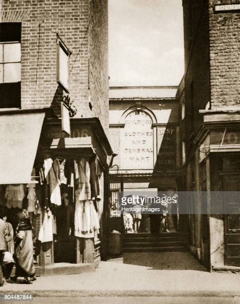 Houndsditch clothing market London 20th century Houndsditch derives its name from the dead dogs thrown in to the moat which once surrounded the market