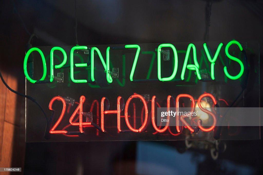 24 hour illuminated neon sign : Stock Photo