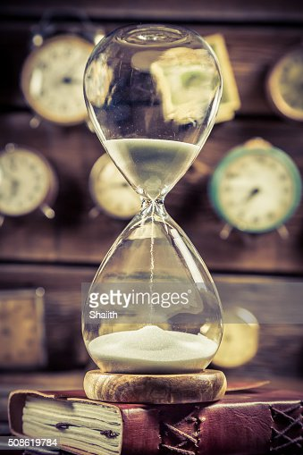 Hourglass on the old books : Stock Photo
