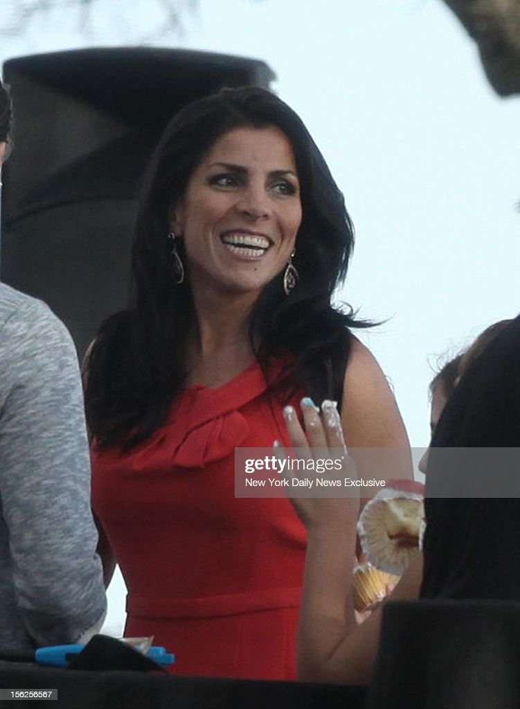 Hours after being identified as the whistleblower in the Gen. David Petraeus scandal, Jill Kelley attends a birthday gathering at her home in Tampa, Fla.