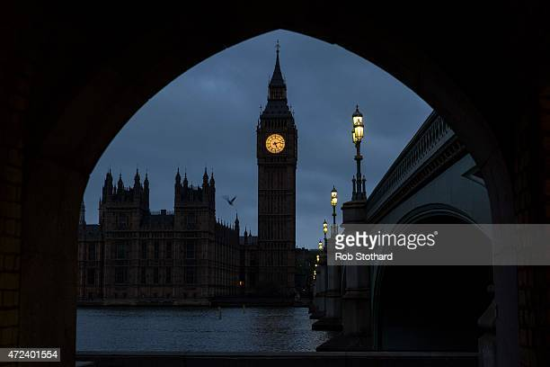 Hours before voters go to the polls a bird flies over The Houses of Parliament by Big Ben on May 7 2015 in London England The United Kingdom is going...