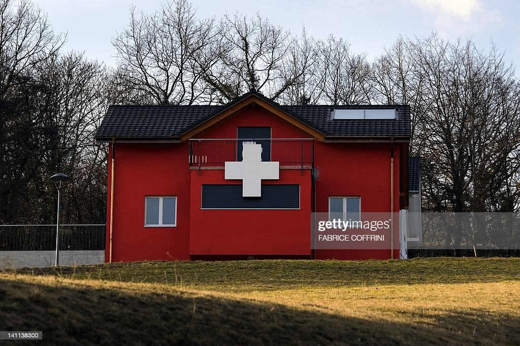 A house adorned with a white cross to resemble the Swiss flag is seen on March 11, 2012 in Moudon. Swiss citizen accepted a referendum at Federal level to limit the construction of second homes in communes to 20 percent. The environmental organisation that brought the initiative argued the construction boom in mountain resorts had led to a waste of natural resources and massively boosted property prices, disadvantaging the local population.
