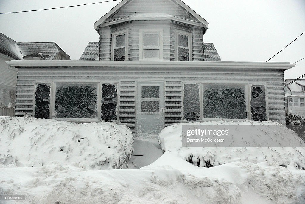 A house along Winthrop Shore Drive is covered in snow and ice on February 9, 2013 in Winthrop, Massachusetts. The powerful storm has knocked out power to 650,000 and dumped more than two feet of snow in parts of New England.