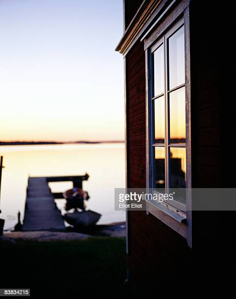A house and a jetty in sunset Sandhamn Stockholm archipelago Sweden.