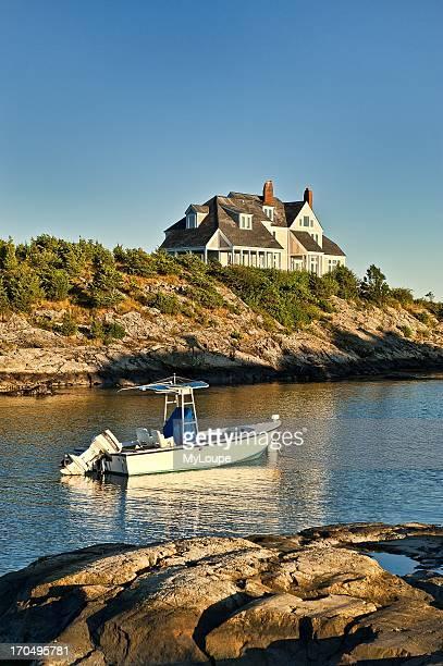 House and boat along Ocean Drive Newport RI Rhode Island United States