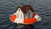 House and lifebuoy on water surface. Help in a crisis situation. Insurance concept.