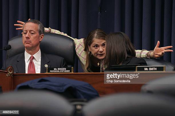 House Armed Services Committee Chairman Mac Thornberry Rep Loretta Sanchez and committee staffer Kari Bingen talk during a hearing about the FY2016...